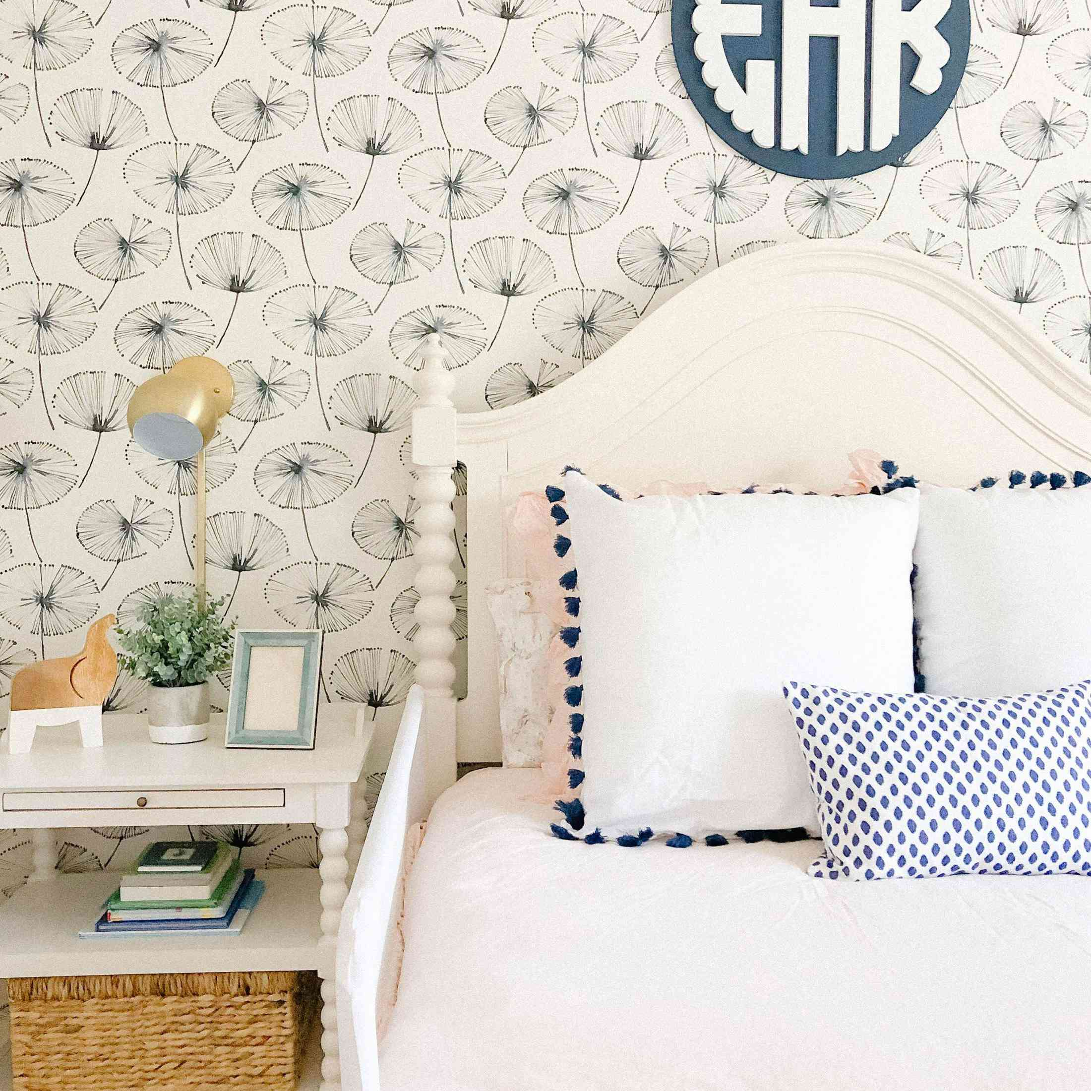 Girl's room with monogram above bed.