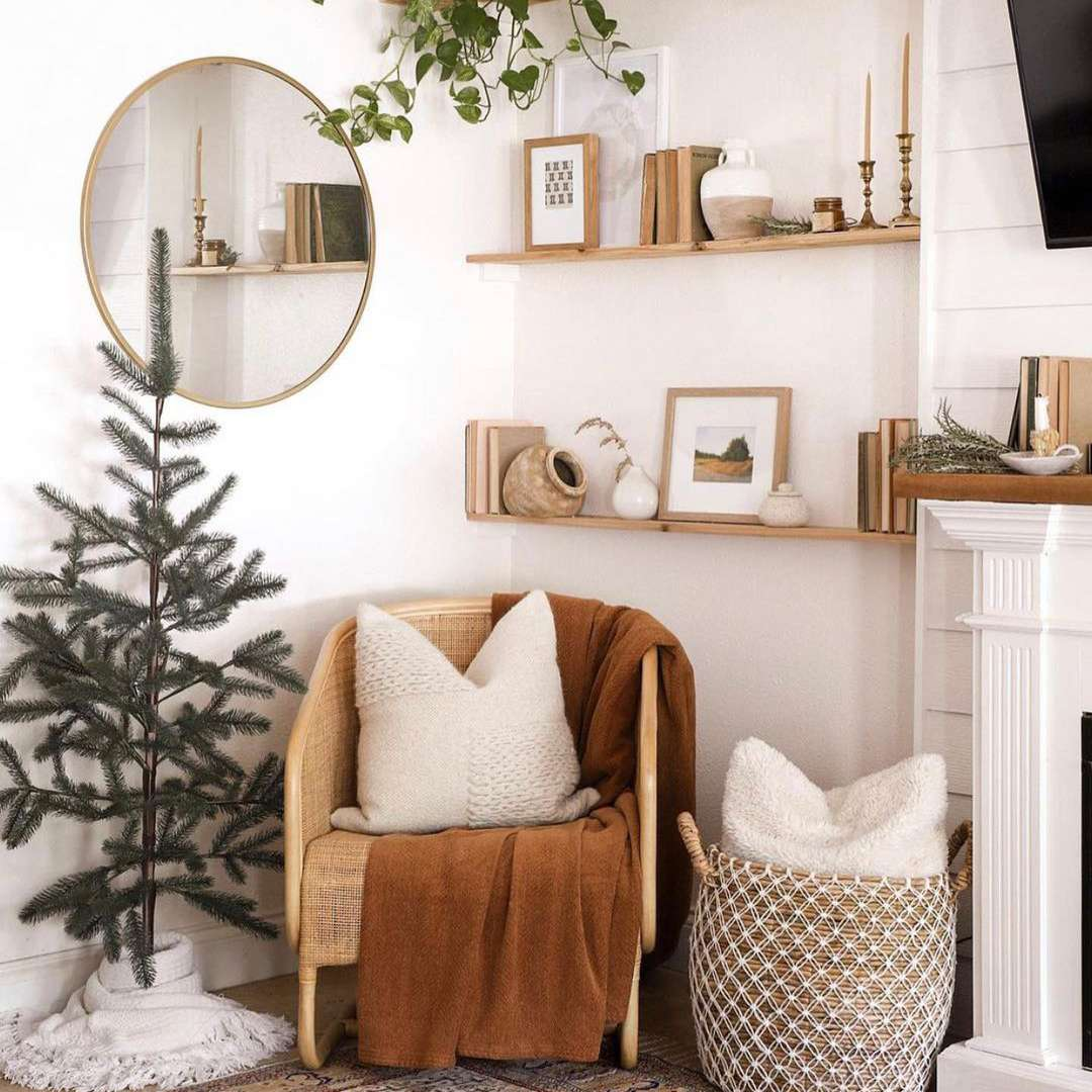 Christmas tree in corner with brown chair.