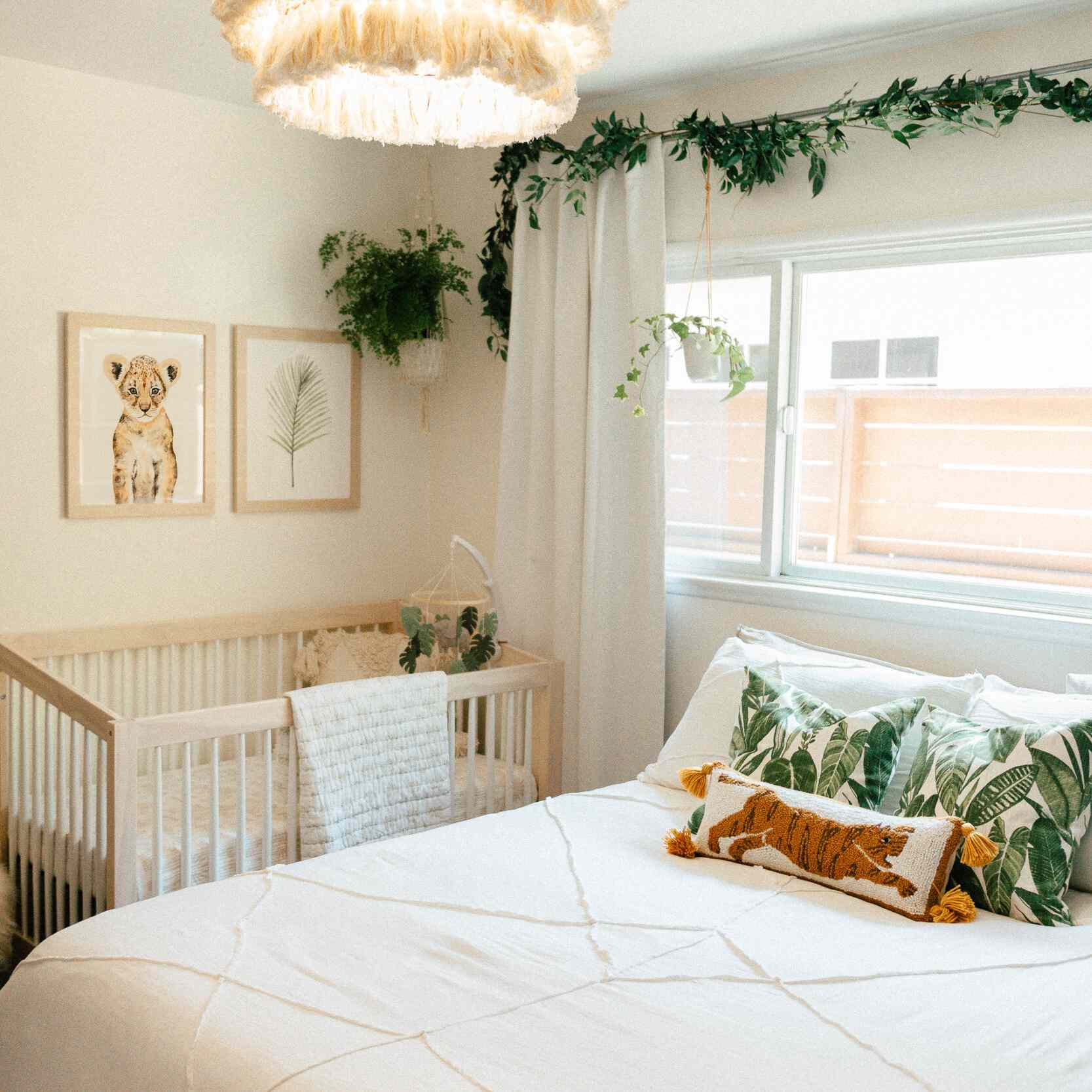 A white nursery with green and orange accents