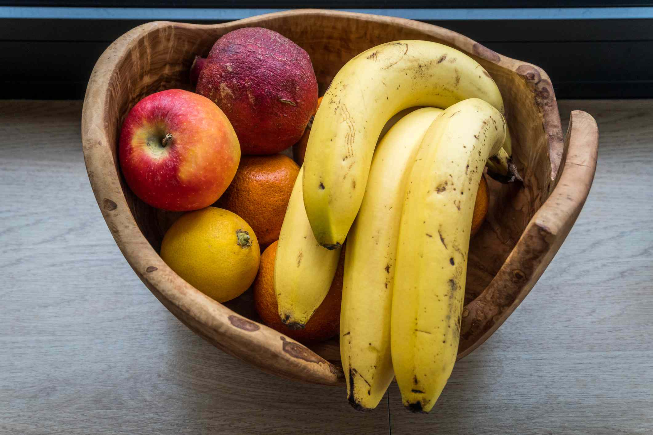 A fruit bowl with apples and bananas