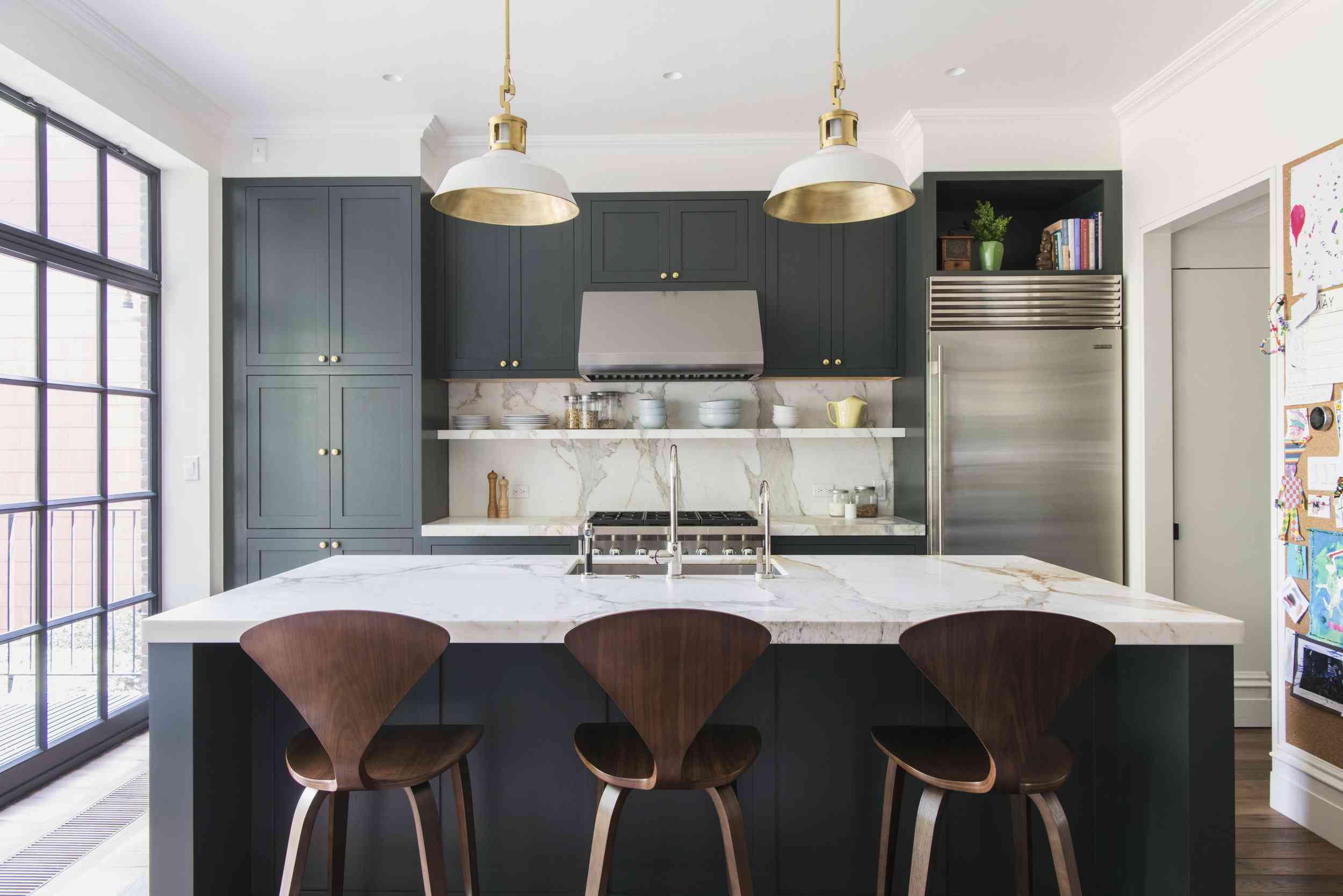Minimalist kitchen with pendant lights, floor to ceiling bay window