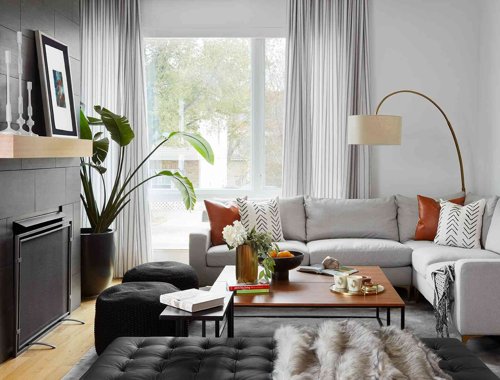 Narrow living room with poufs for extra seating