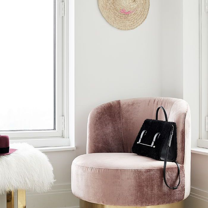 a rose chair in Ashley Benson's New York City Apartment