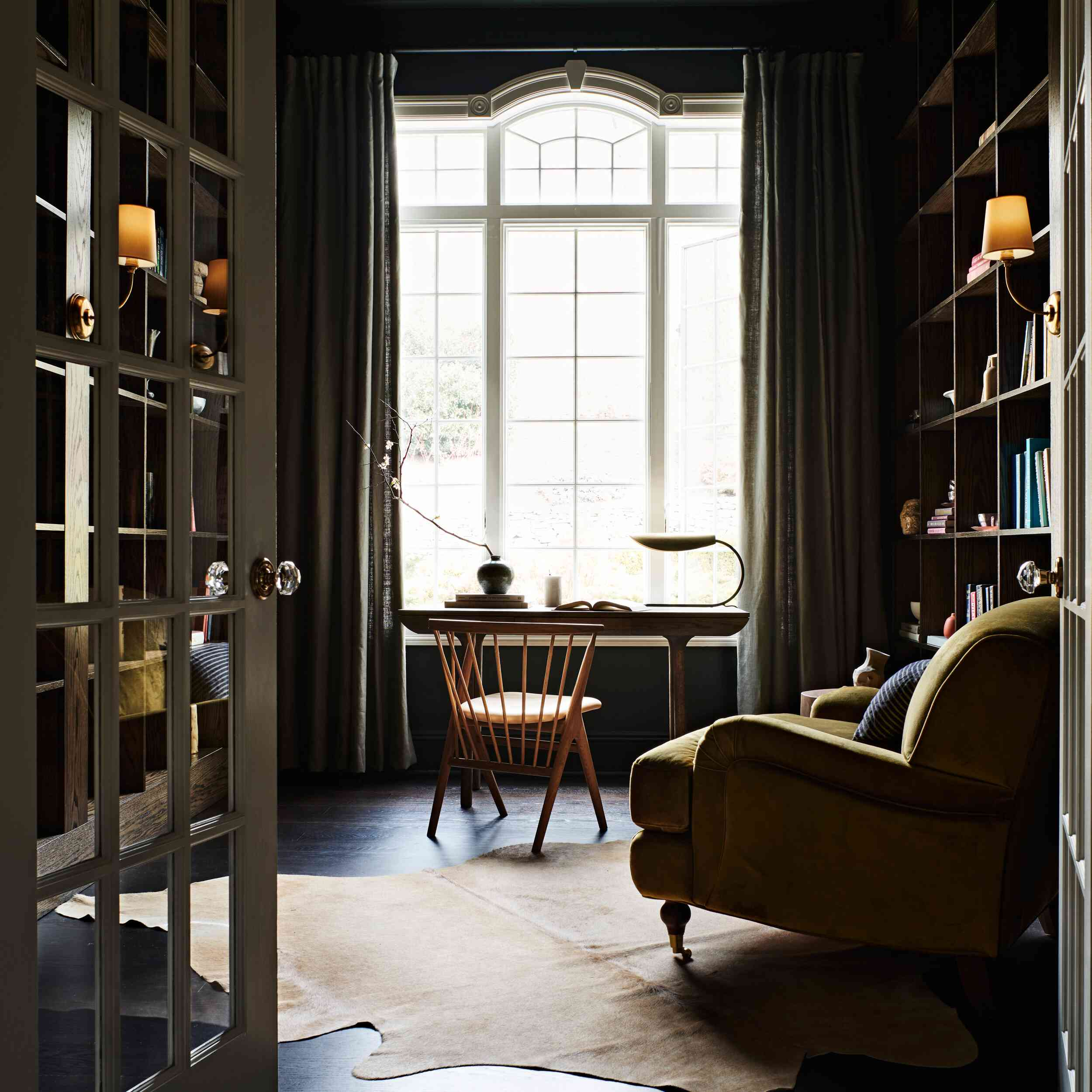 Small study with floor-to-ceiling bookshelves