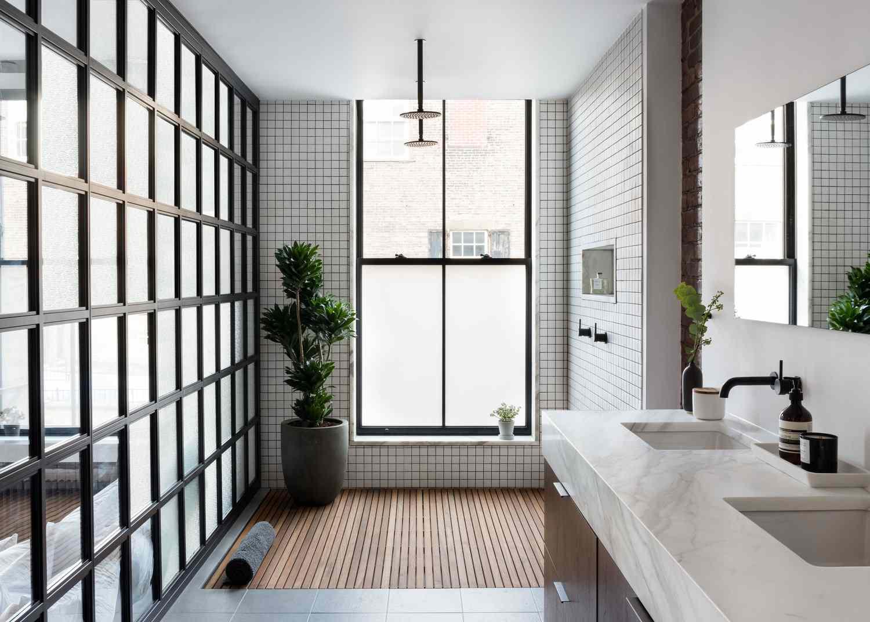 White tiled bathroom with teak shower floor.