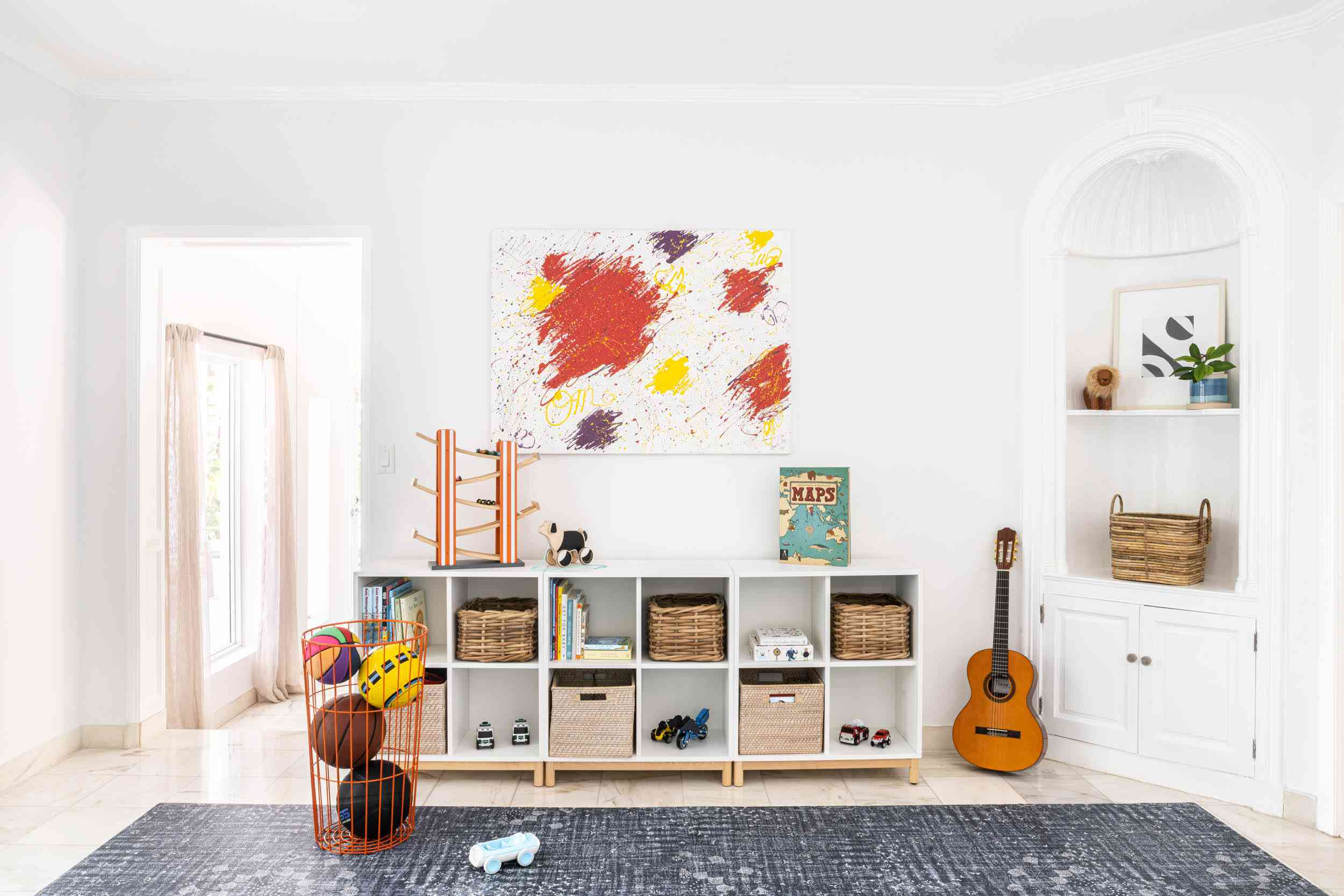 Playroom with built in cubbies.