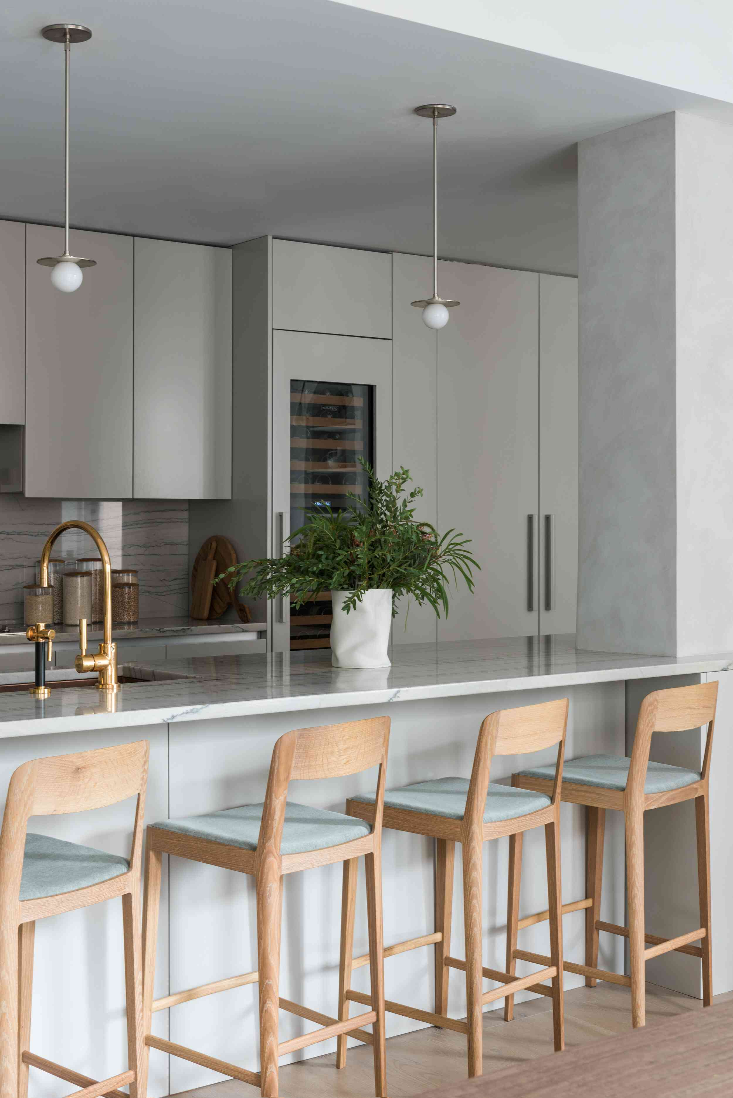 A sleek kitchen with light gray cabinets