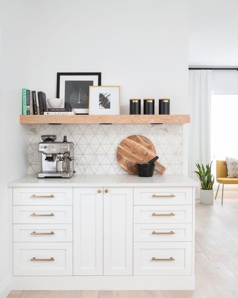 White, gold, and wood coffee bar with espresso maker