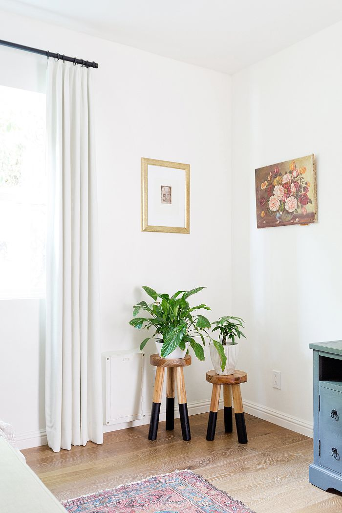 bedroom nook with plants on stools