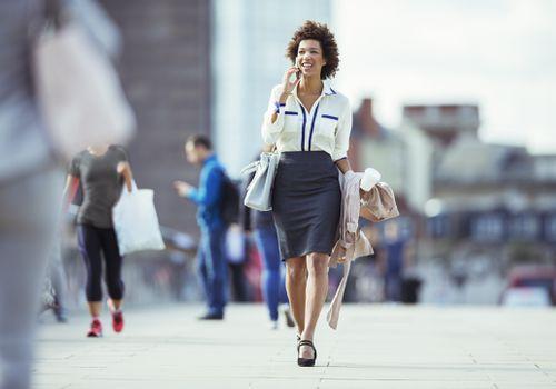 Professional woman walking outside