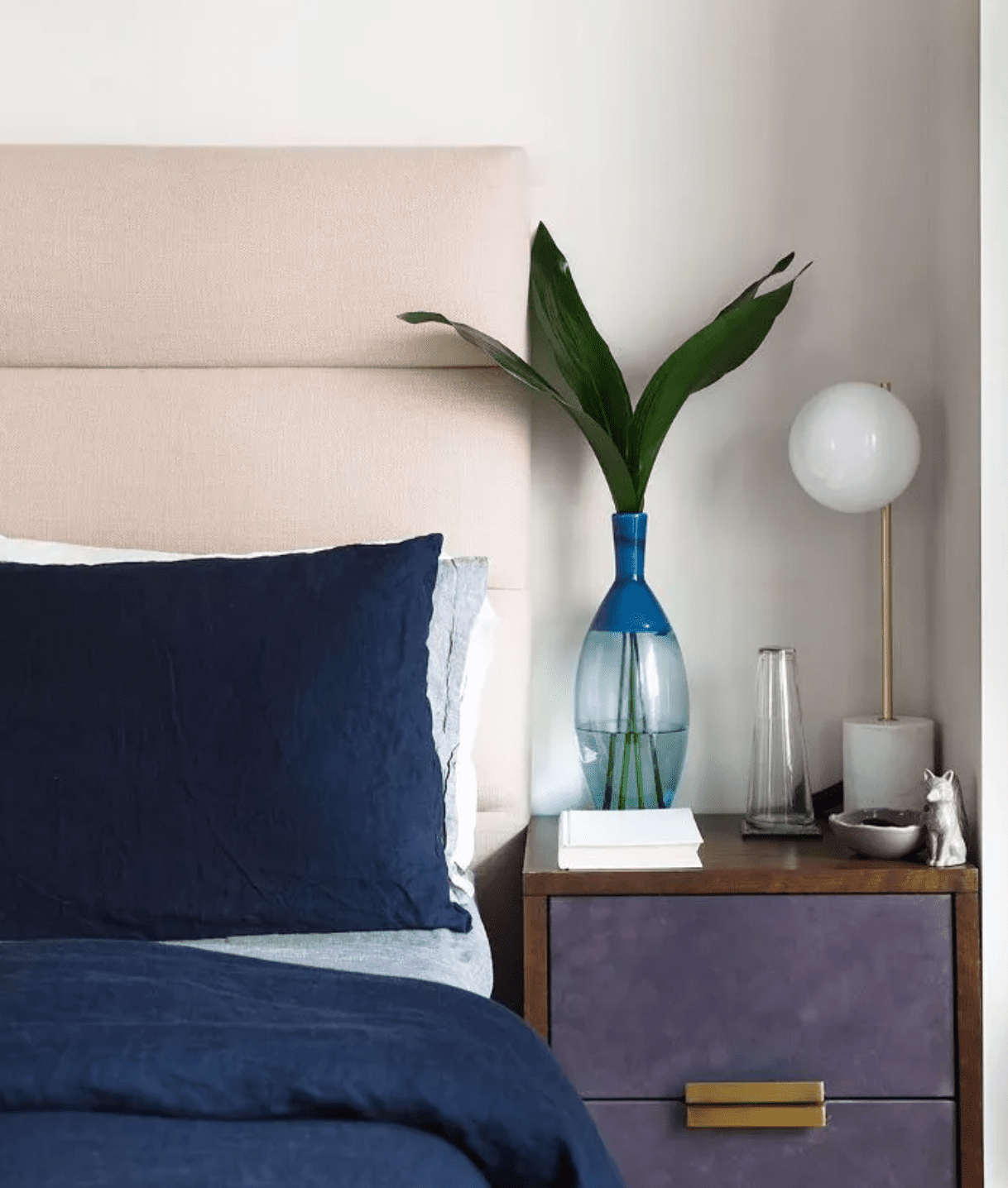 Bedroom unified by blue and purple tones