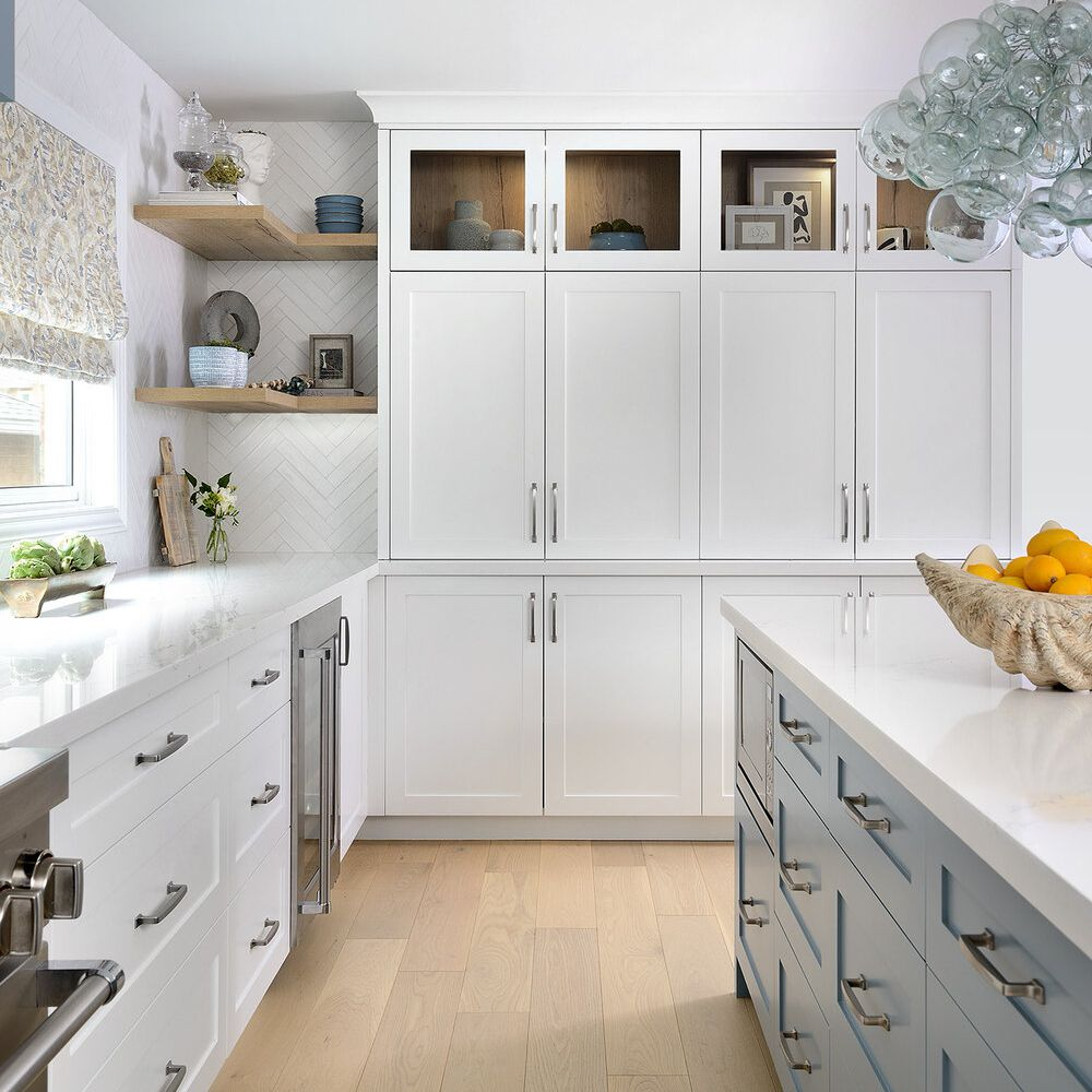 Side view of kitchen with light wood flooring.