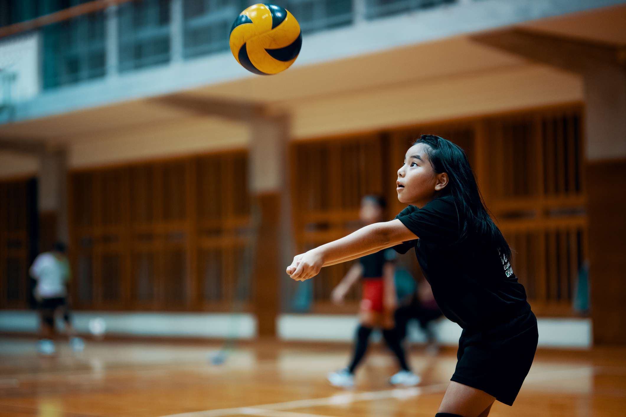 Young girl plays volleyball