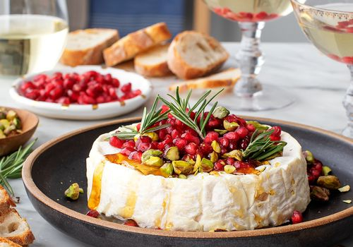 Baked brie with pomegranates and pistachios
