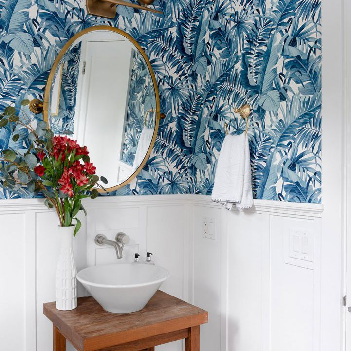 how to clean walls - bathroom with blue botanical wallpaper