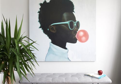 Painting of young Black boy blowing bubblegum bubble