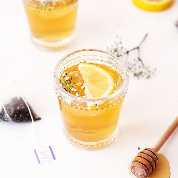 Two glasses of tea with lemon slices and honey