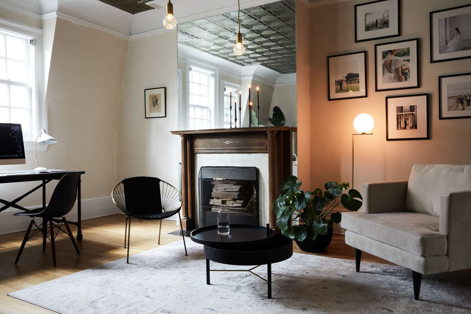 Small living room with a mirror above the mantle