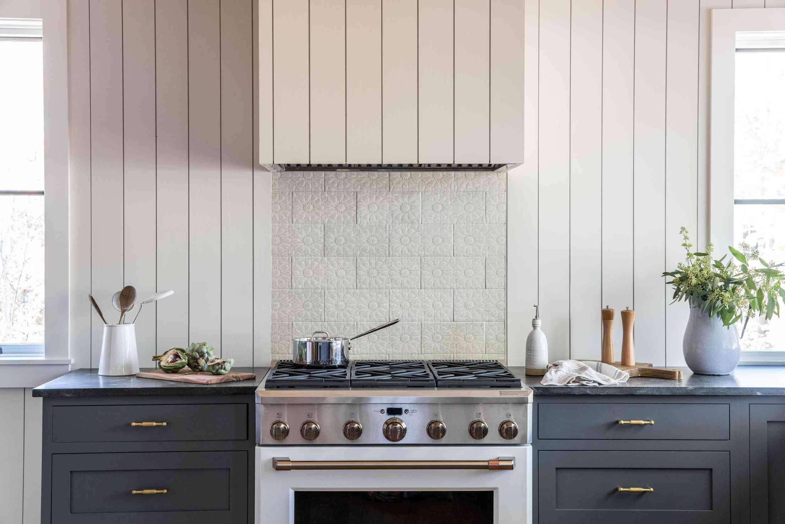 A kitchen with an ivory backsplash