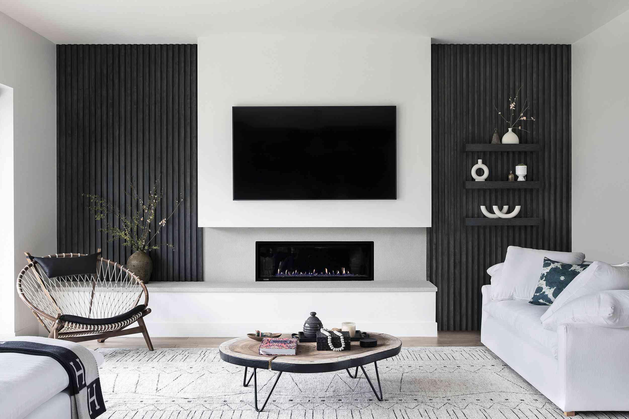 Sleek and modern black and white living room showcasing asymmetry