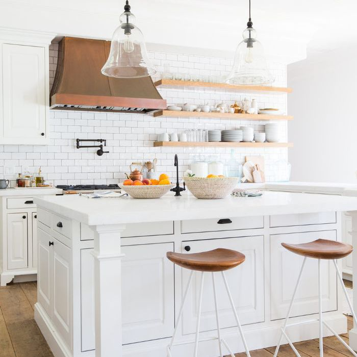 a kitchen with white marble countertops