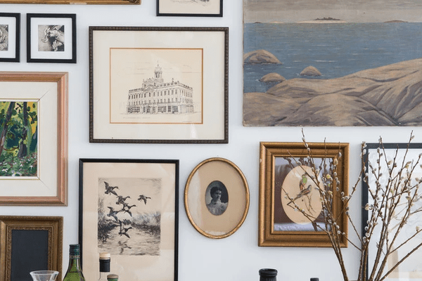Large gallery wall of vintage art.