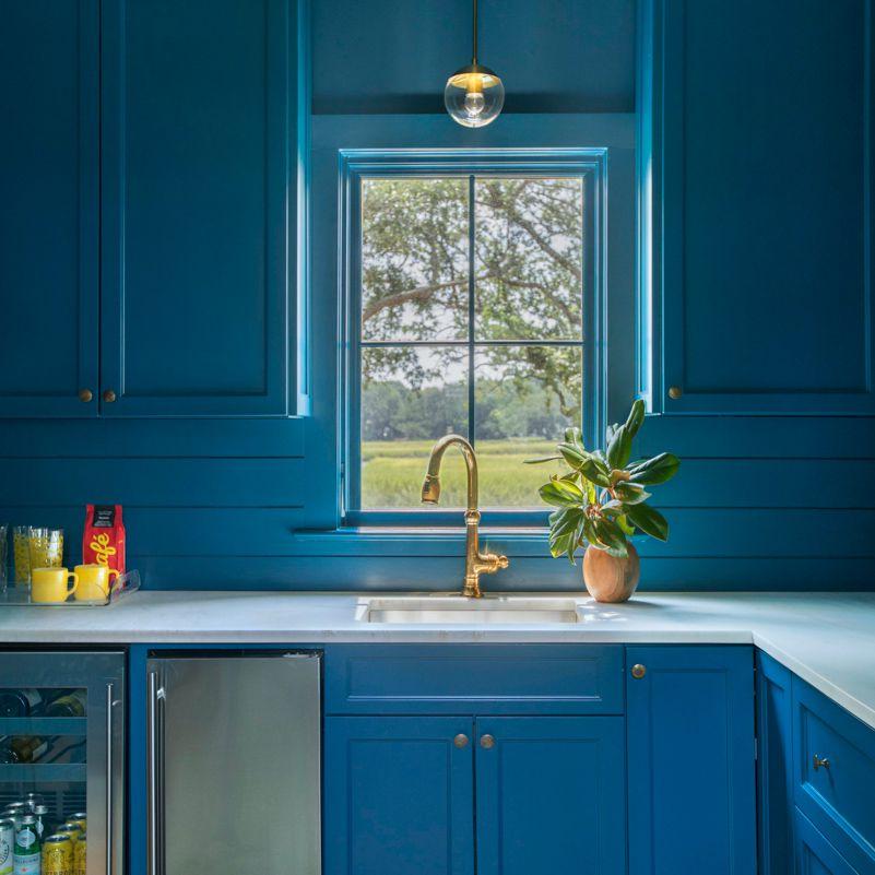 Bright blue wood-clad kitchen