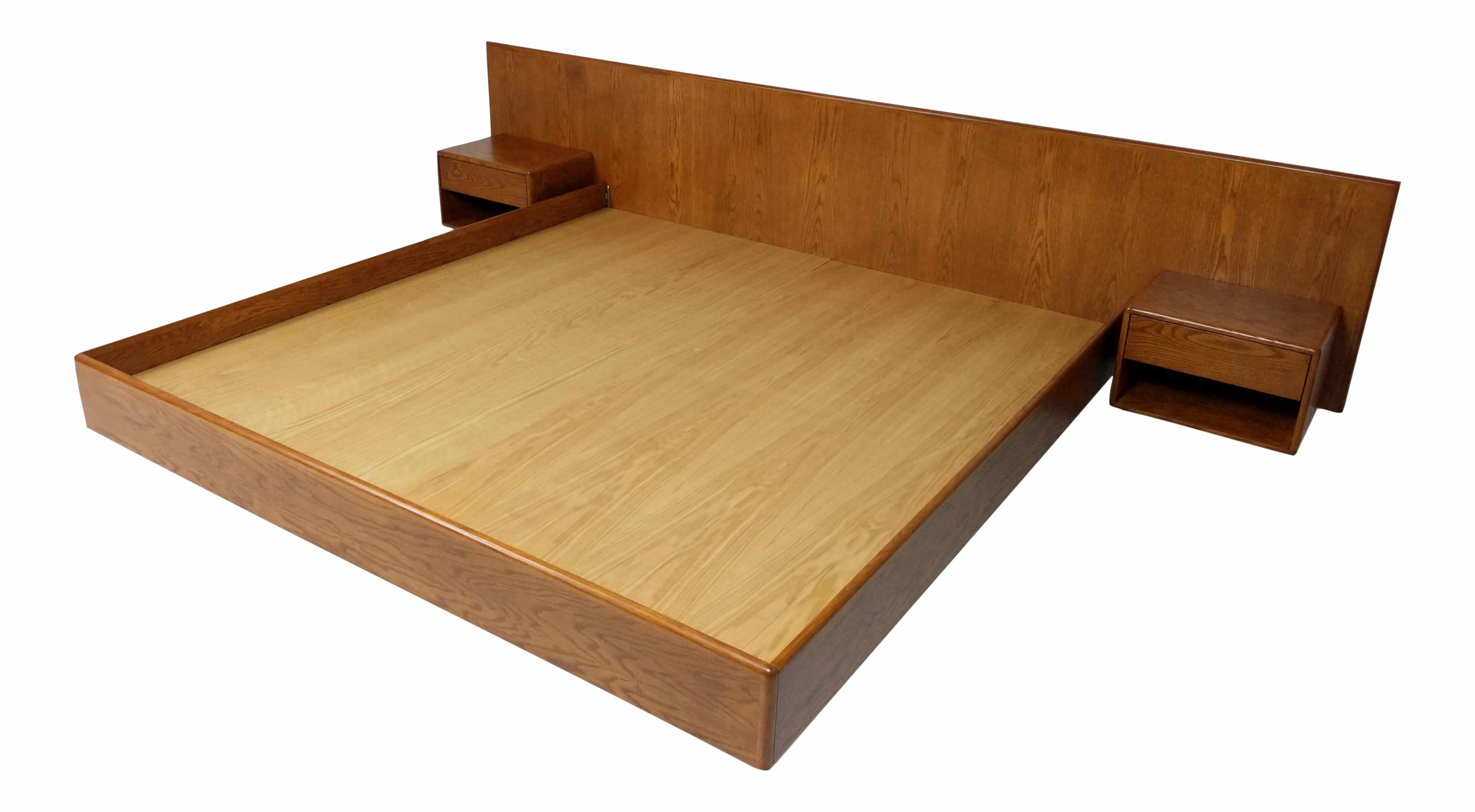 A wooden platform bed with a built-in headboard and nightstands.