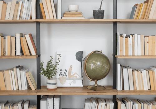 Styled bookshelves with globe.