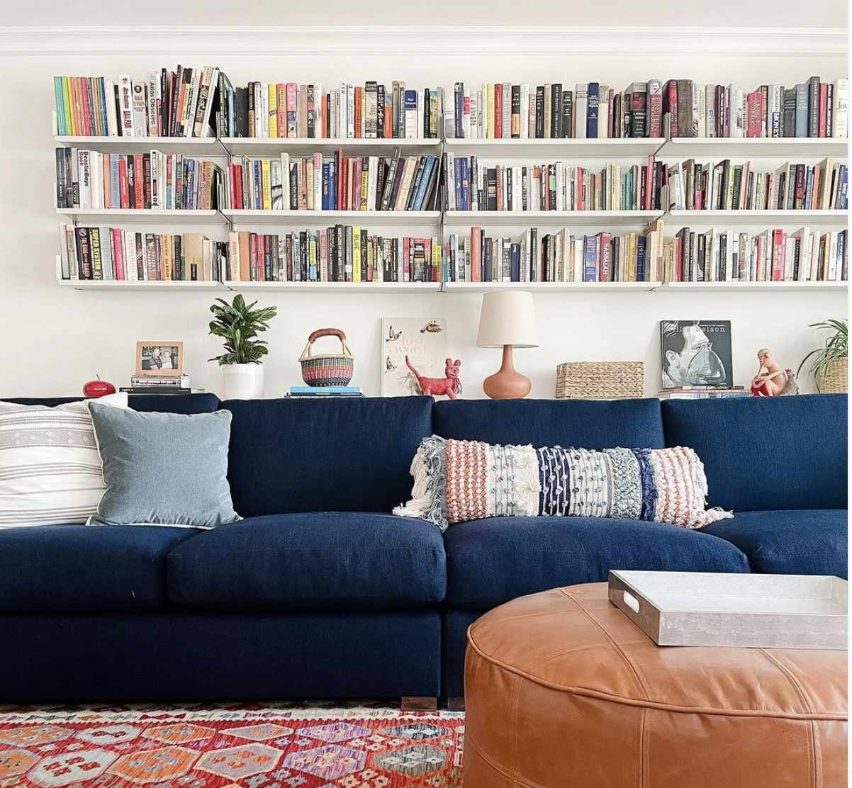 stacked sets of floating shelves serving as a bookcase