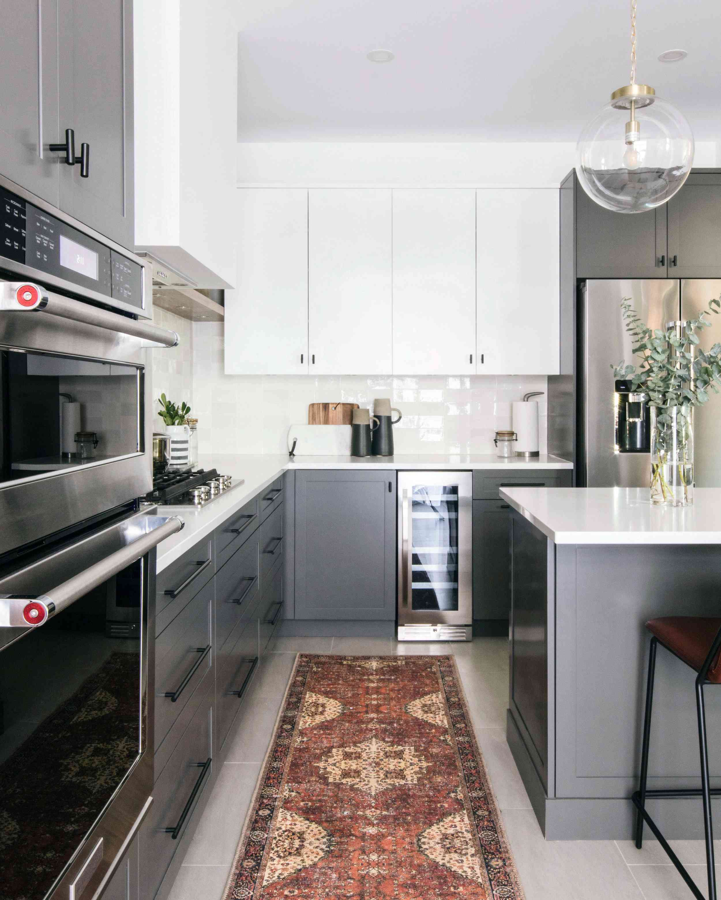 best kitchen ideas - gray kitchen with rust kitchen runner rug
