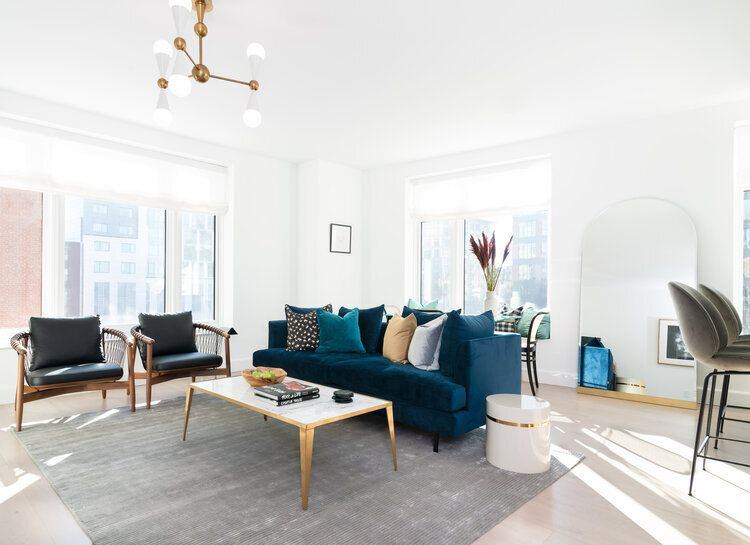 blue and gold living room, navy couch and gold coffee table