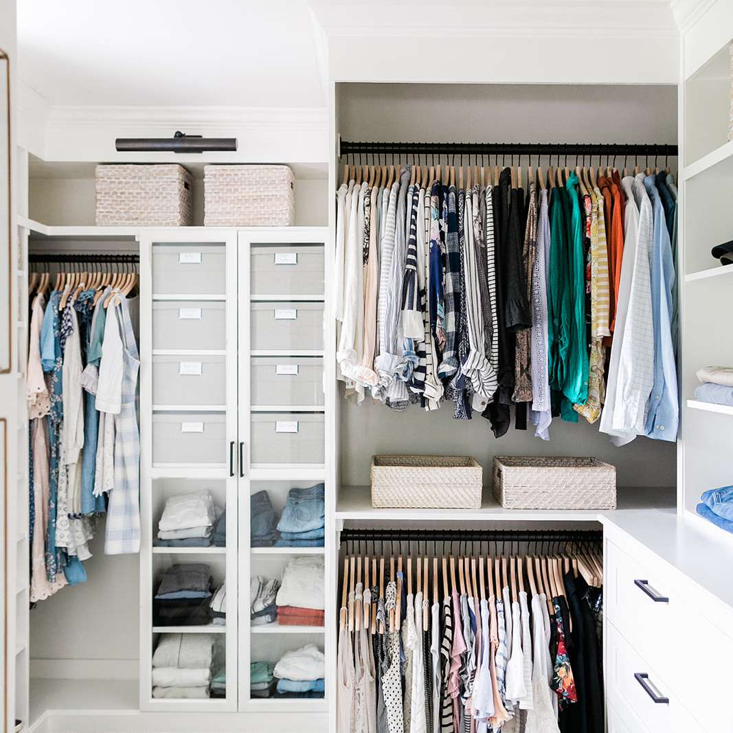 A closet outfitted in IKEA shelves, cabinets, and drawers