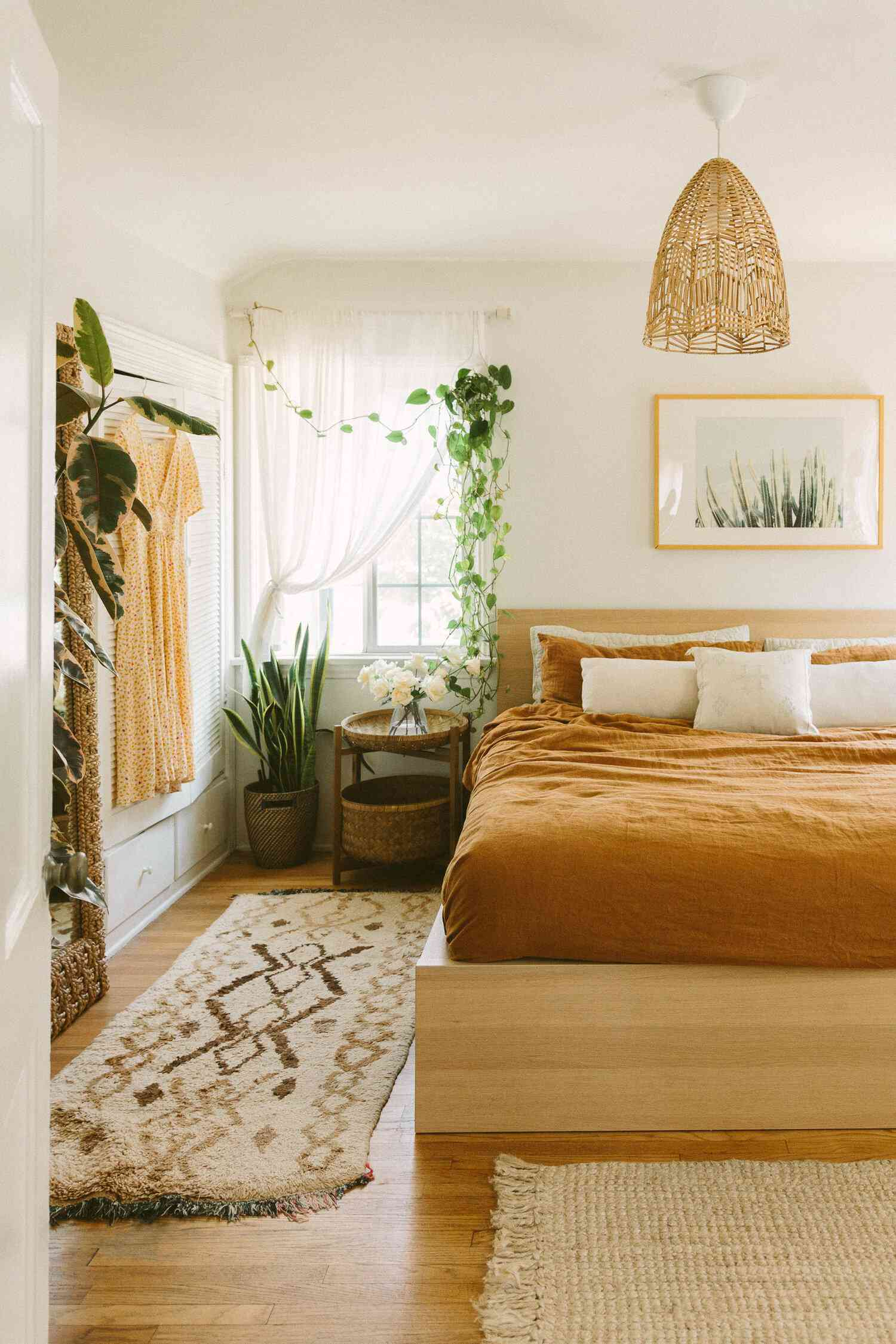 Boho bedroom with wood bed