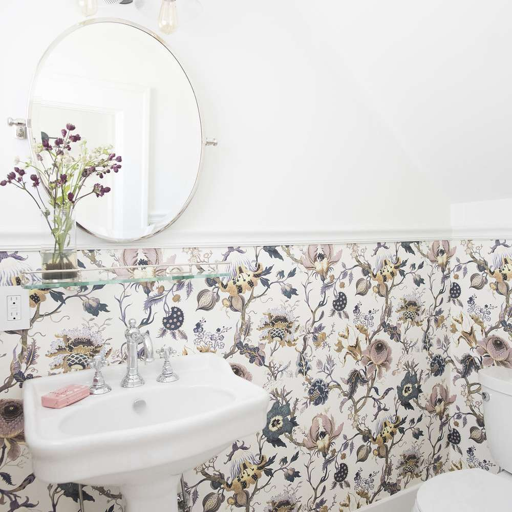 Vintage-inspired bathroom with wallpaper