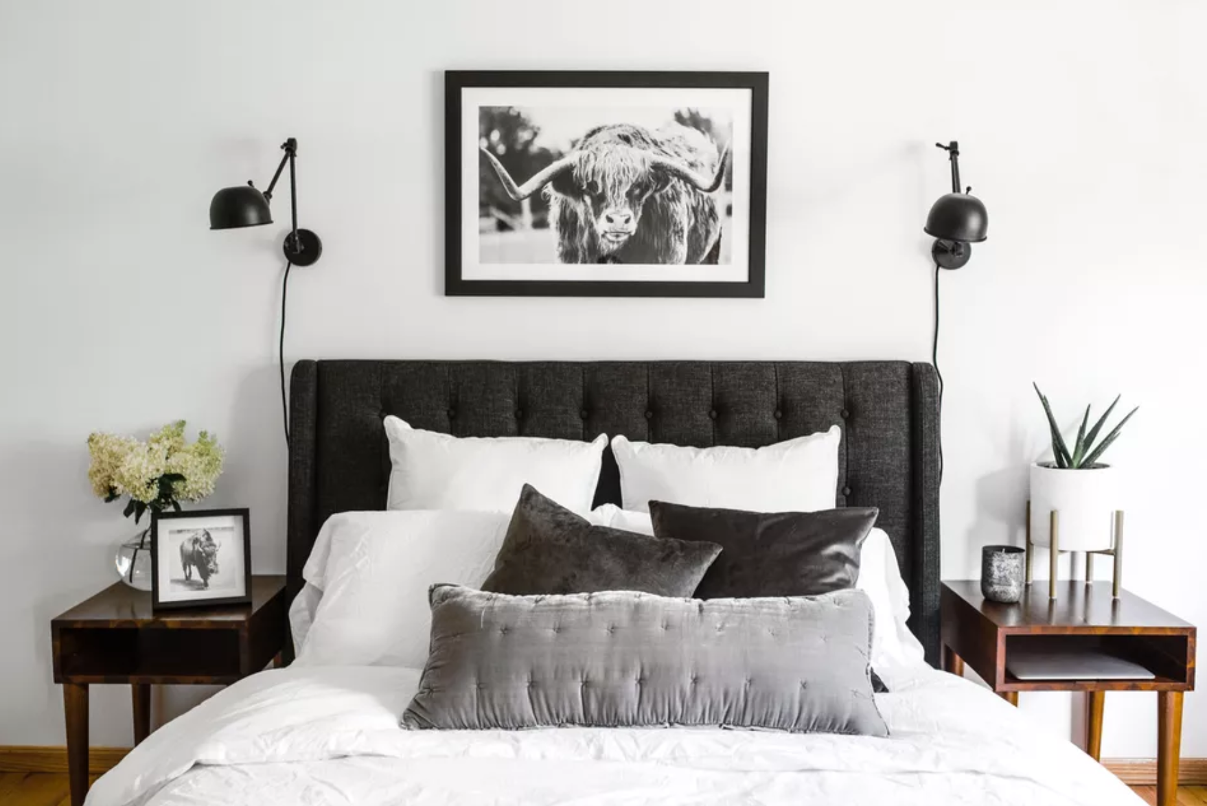 Bedroom with two nightstands with storage space beneath