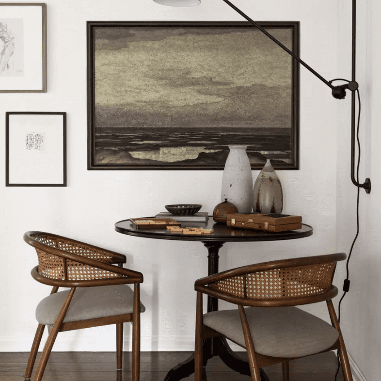 A dining nook lit with a wall-mounted industrial task light