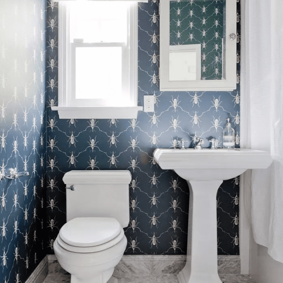 Tiled bathroom with blue patterned wallpaper