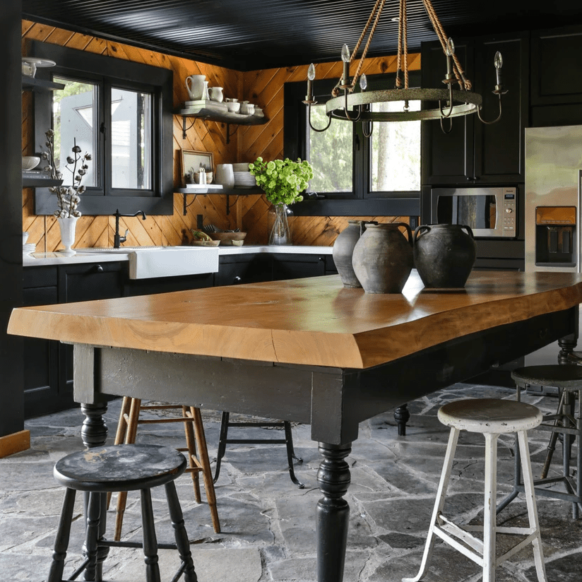 A dark kitchen with black ceilings and accents