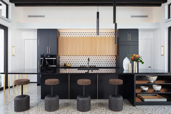 Black kitchen with black and white tile.