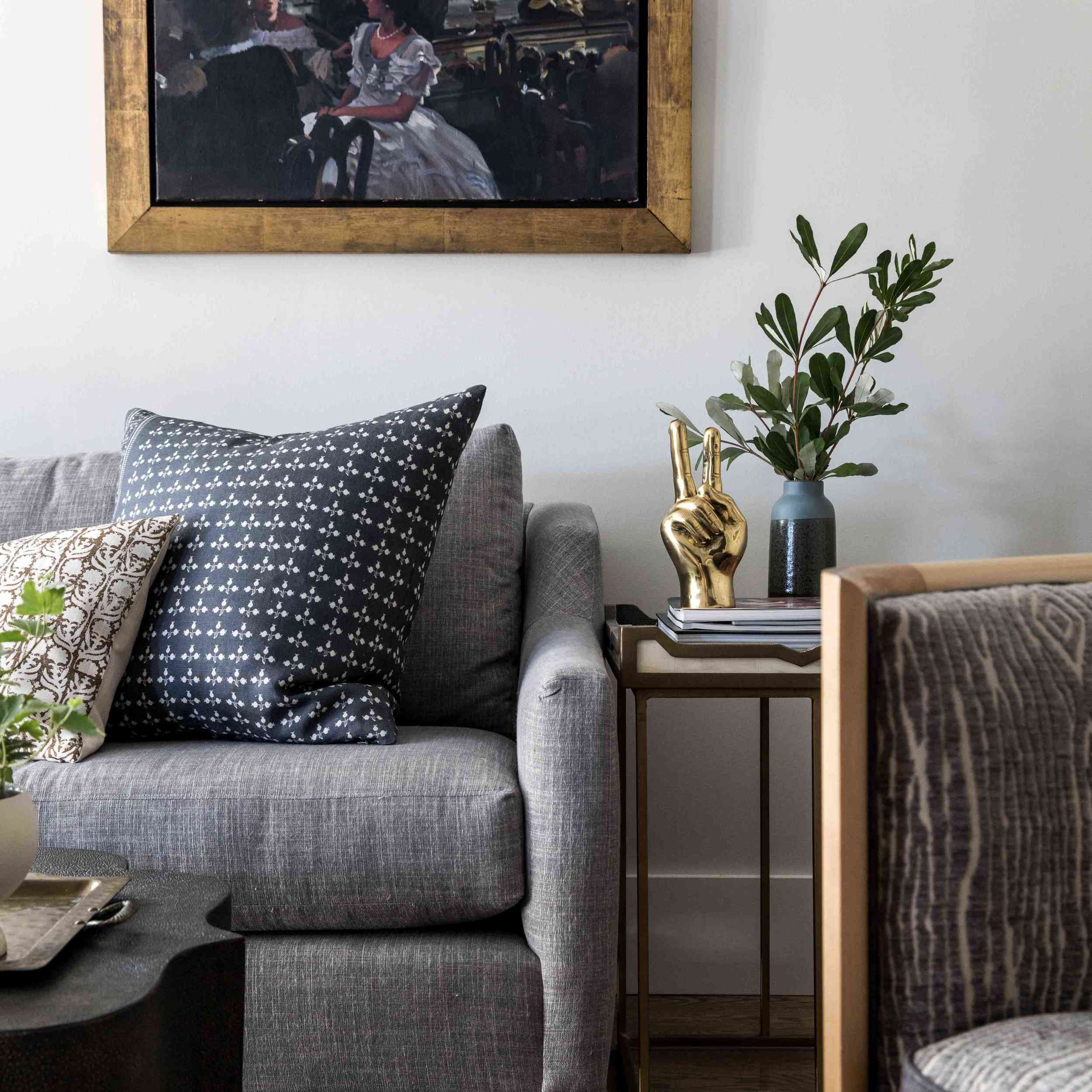 best living room ideas - vintage painting with modern accessories