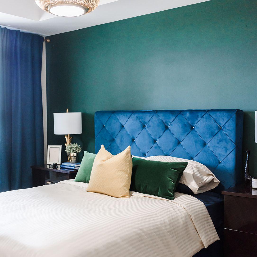 Jewel-toned green bedroom wall.