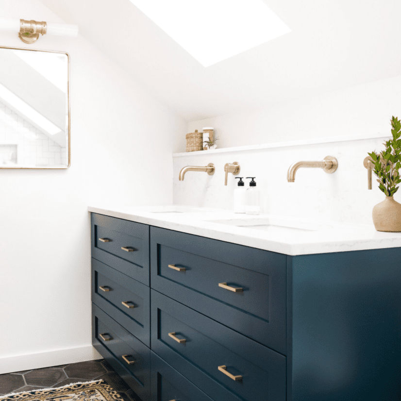 A small bathroom with a blue double vanity