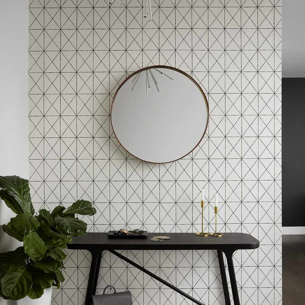 Apartment entryway with wallpaper feature wall