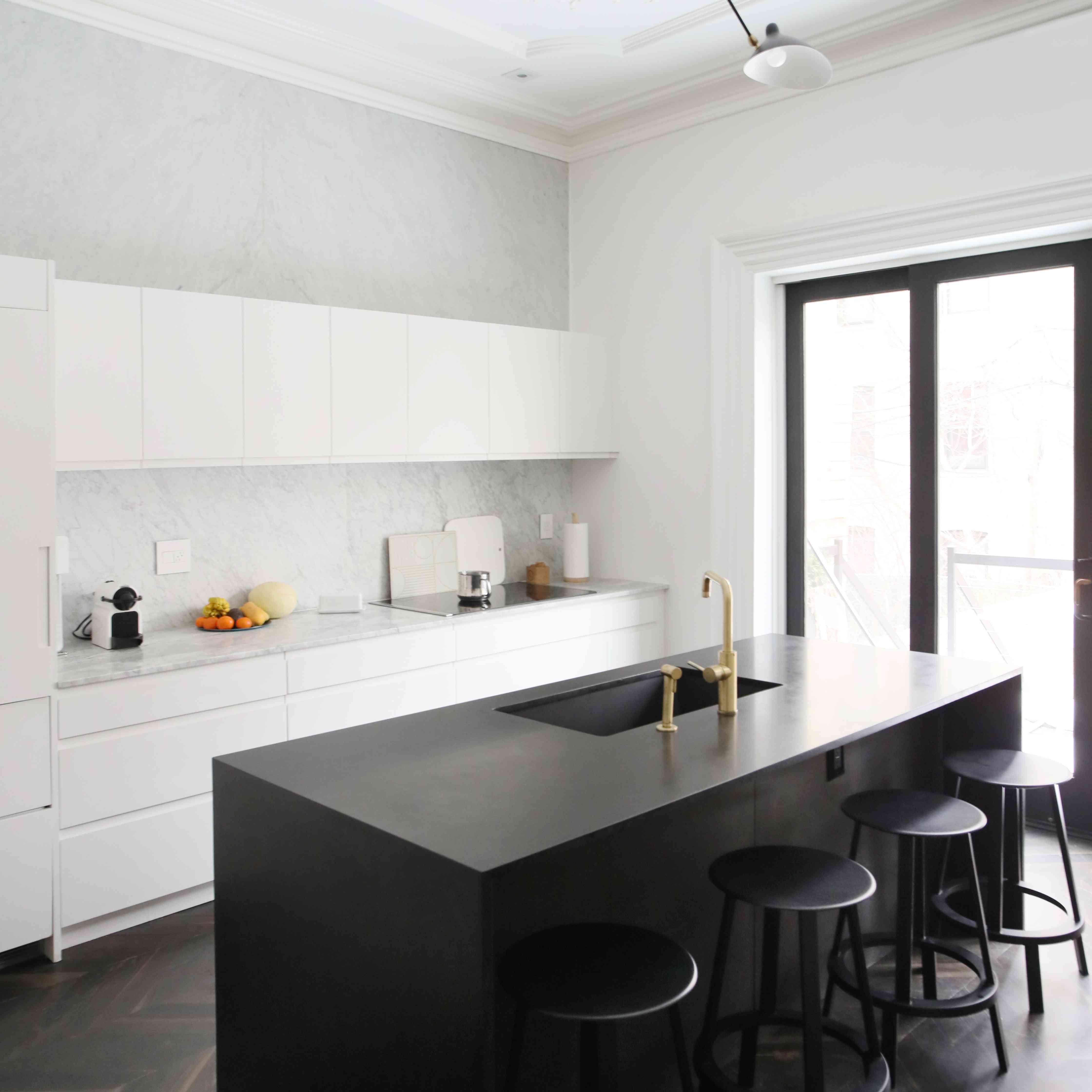 white kitchen with black kitchen island