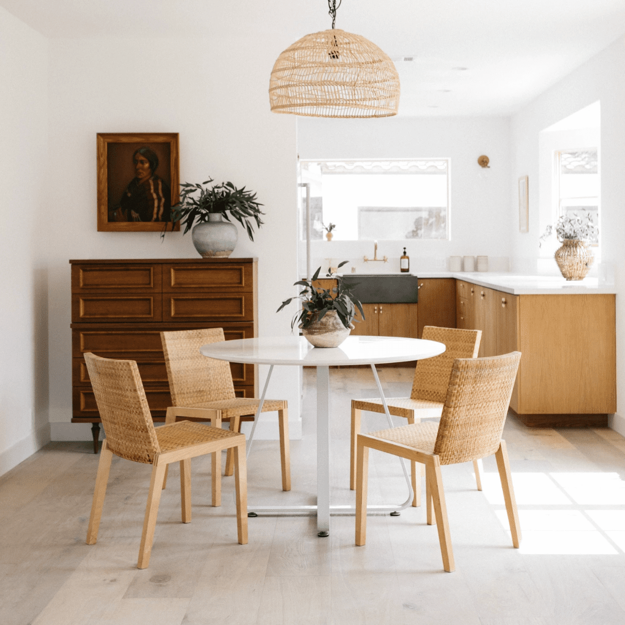 An open-concept kitchen leading into a small dining room
