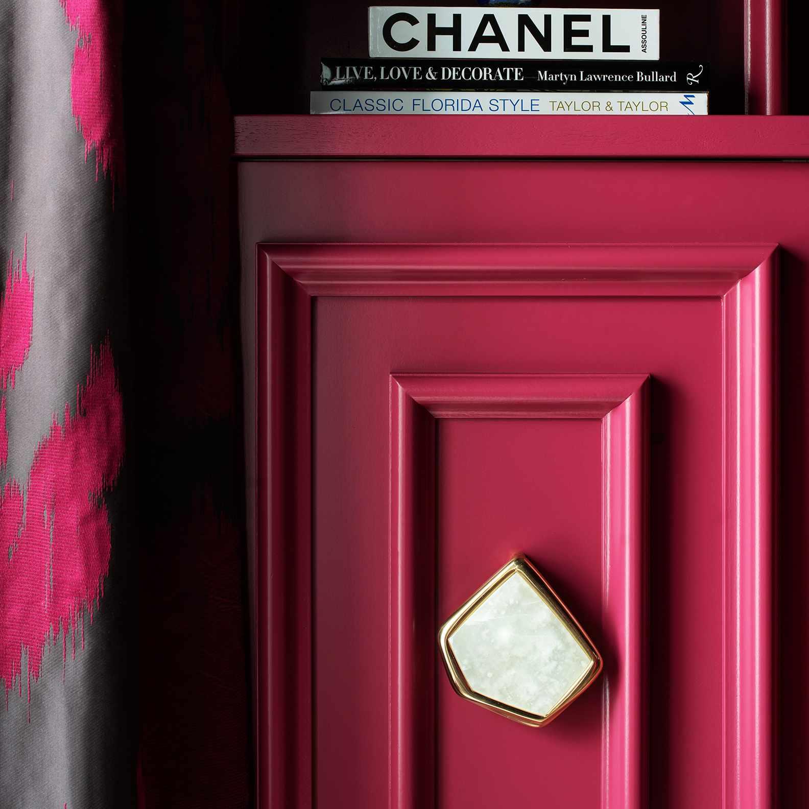 Lisa Gilmore's favorite room - raspberry den detail shot with books and vase