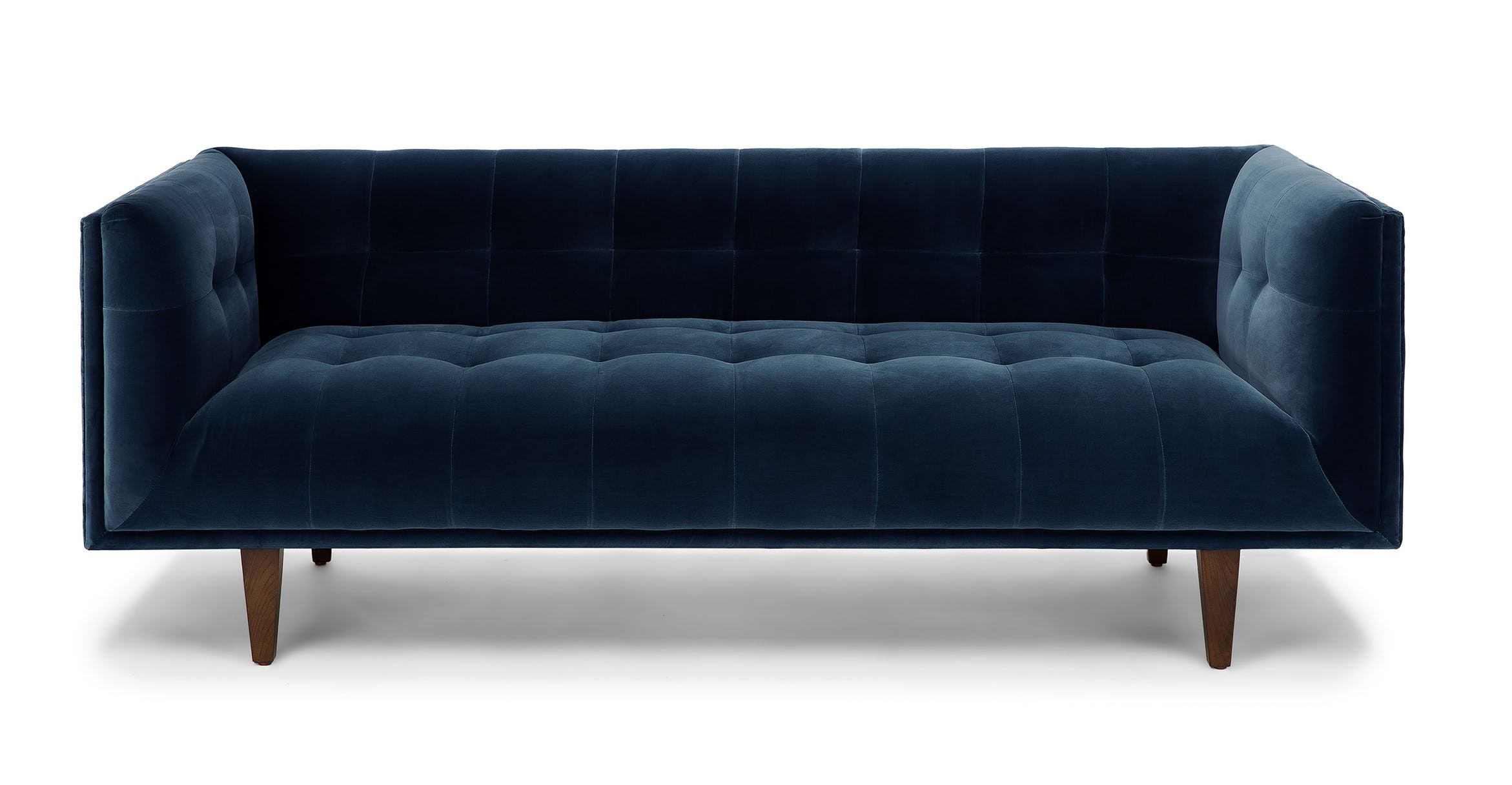 A tufted navy blue velvet 3-seater sofa with tapered wooden legs.