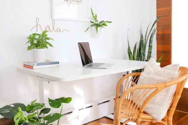 Office desk with a wicker chair