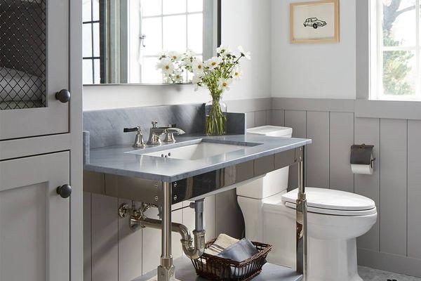 Neutral hued bathroom with hexagonal tiled floor